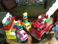 Large push pull Fire truck with lots of mega blocks and