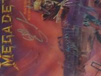 Megadeth piece sells lp Signed by all original members