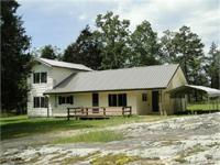 Here is an old country home that sets on 1 acre more or