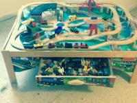 Melissia and Doug wooden train set. Table with tracks
