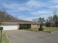 Immaculate brick home situated 1 block from CountryClub