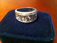 This is a men's 2 carat white gold 5 stone diamond