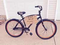 Nearly new. Just 1-2 miles of use. Black w/orange trim.