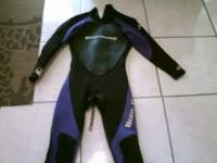 Greetings. Here I'm selling an purple wetsuit by the