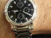 men's diamond & stainless steel watch retails for 700