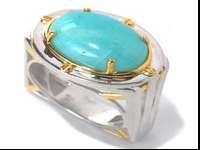 A strong design topped with a bright blue gem! Crafted
