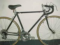 Lugged steel frame bike with pretty fancy lugs, made