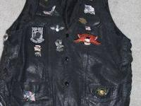 This all leather vest with silver conchos and braided
