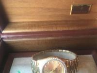 I am selling a men's Rolex 18 karat yellow gold present