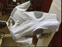 HEAT GEAR padded compression shirt for football season.