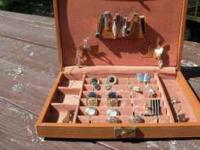 Vintage box of men's cufflinks and tie bars. $35.00