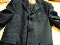 Very nice black suit with gold pinstripes. Purchased in
