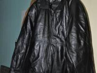 This gently worn Men's black leather jacket in a size