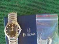 im selling a mens bulova watch that comes with extra