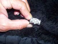 ONE AND HALF CARAT MANS RING. IT IS WHITE GOLD