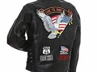 Features patches on front and back; zippered front;