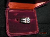MENS DIAMOND RING , 1 CARAT TOTAL WEIGHT. VERY COOL