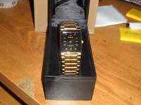 This quartz watch is new in the Box. Has Gold dials