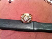 Very nice gold and diamond ring.I paid $799.00 on a 20%