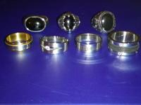 Have 7 Mens stainless steel and onyx rings, size 10,