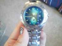 mens stainless steel blue fossil watch. very little
