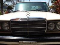 Mercedes-Benz 240 D (diesel). The auto is in excellent