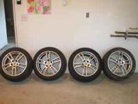 NICE AFTER MARKET RIMS ON PIRELLI SNOW TIRES, TIRES ARE