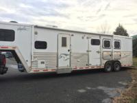 2009 Merhow 3H Horse Trailer with slide out and 12' LQ.