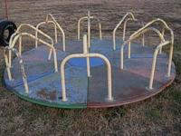 Used 10 foot round merry-go-round. Will need a pole or