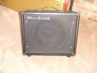 Mesa/Boogie 12' cabinet solid wood with a Black Shadow
