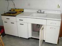 white metal sink with base cabinet. we bought a house