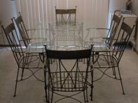 This seven piece dining set was purchased at Pier One