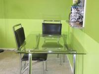 From Pier 1 Imports. Metal and glass dining table and 4
