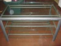 This is a glass TV stand. It has some scatches on the