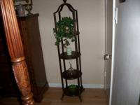 This is a awesome curio/plant stand that is made of