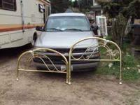 Full-size metal bed frame; headboard and footboard.