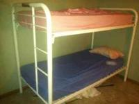 Up for sale, a metal bunk bed w/ mattress. 100.00 OBO.