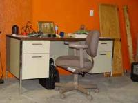4 Drawer metal desk and swivel chair. Desk measures 60""