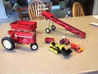 Metal International tractor, farm wagon, conveyer belt