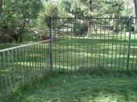 $900 for 200 feet of black steel fence and gates. Will