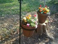These metal flower pot holders are nice yard décor &