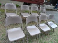 For sale is a set of eight metal folding chairs from