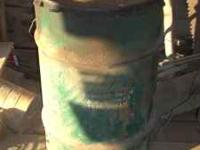 I'm selling a metal grease barrel. It is dirty, but in