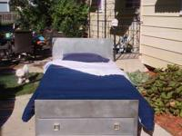 All metal twin bed with 2 drawers in the footboard.