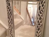 Metal intwined mirror with a beveled edge. . ..GREAT