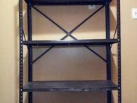 Metal storage rack with 5 shelves.  this rack was used