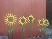 Metal Sunflowers made from farm equipment, hand