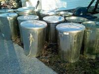 We have 21, 30 gal. metal trash cans with lids for