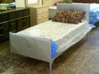 Selling is a twin bed that consists of a metal