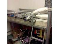 Twin size metal captin's/loft bed. Attachable side